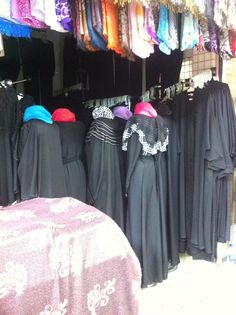 Prayer time in Souq. Shop owner turned mannequins around.