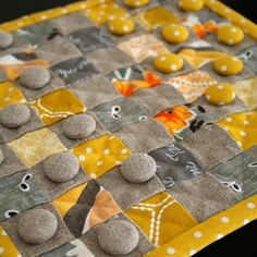 ...Neat could use fabric scraps or unwanted textiles to create a checker board!