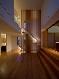Down-lights from railing showcase stairs behind slatted wall. Lovely. masahiko sato: K5-house