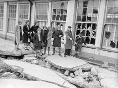 School children inspect bomb damage in the playground of Moorside Road School, Grove Park, London. One boy is pointing to a large hole in the concrete of the playground. Several of the windows have been smashed. All the boys are carrying their gas masks. Vintage London, Old London, Kent England, London England, London Bombings, Good Shepard, Grove Park, The Blitz, Battle Of Britain