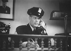 0 Jack Mower on the phone in lady gangster 1942