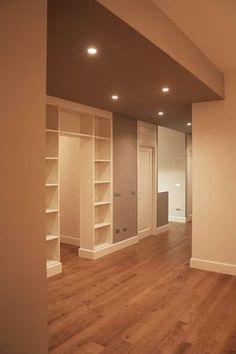 legno, beige, librerie: Soggiorno in stile in stile Moderno di Architetto Luigi Pizzuti