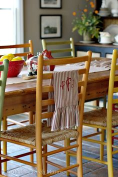 Love the different colored chairs around the table