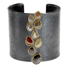 18ky gold and sterling silver with patina and fancy cut diamonds (19.145ctw)