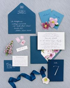 Southern Fried Paper created the custom suite, which was letterpressed on to thick cotton paper, tucked into blue envelopes lined with a watercolor floral design inspired by a painting in the couple's home, and mailed to guests thanks to calligraphed addresses penned by The Left Handed Calligrapher.