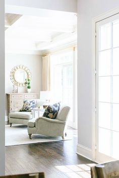 Sitting area with natural light and off-white armchairs