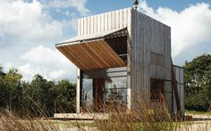 HUT ON SLEDS / Whangapoua « Crosson Architects....Interesting morphic design. Great for sun shading and indoor-outdoor adaption for weather conditions.