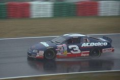 Dale Earnhardt in a car sponsored by ACDelco racing at Japan in the rain