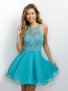 This classy and chic design has an illusion high-neck halter with a sweetheart neckline and cute flared skirt, and it's at Rsvp Prom and Pageant, your source for the Hottest Homecoming, Prom, and Page