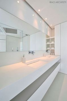 | BATHROOM + DETAILS | vanity with integrated sinks & storage below | #modern #white | when interiors use a singular colour palette