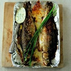 trout - two 6-7 oz rainbow trout; 1 oz butter, plus a little extra, melted, for brushing foil and the trout; 3 fl oz creme fraiche; 1 bay leaf; 2 T chives; s & p;  line pan with foil and brush w/melted butter. Place trout in pan & brush with melted butter & s&p. Bake in 425 oven 10-15 minutes. Pour the crème fraîche into a saucepan, add the bay leaf and bring to a simmer. Remove bay leaf & add chives and 1 oz butter, s&p pour this mixture into a warm jug and pass w/fish.