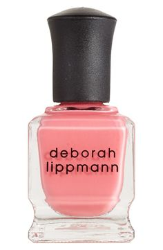 This pretty pink nail polish is the perfect summer shade.