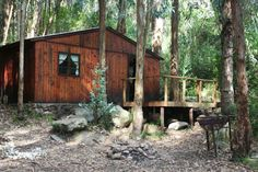 """Die Boshuisie"" Situated privately in a kloof - for the more adventurous! This four bed (2 x double bunks) self-catering wooden cabin has separate ablution facilities with hot water (2 x flush toilets, shower, hand basin & sink). There is no electricity, but gas lights, gas stove, gas hot water geyser, gas fridge as well as pots, crockery and cutlery are available in the kitchenette. It has outside braai facilities. No bedding or towels are provided. Water Geyser, New Modern House, Double Bunk, Self Catering Cottages, Gas Lights, Flush Toilet, Wooden Cabins, Basin Sink, Gas Stove"