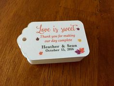 This listing is for set of personalized TREAT favor tags for a fall themed wedding with the caption LOVE IS SWEET  SIZE: 2.5W x1.5H Cardstock: 80lb acid free WHITE cardstock Font Color: The fonts and wordings on this tag are pre-set. You can change the color of the words to match your wedding colors. Ribbon: White/Ivoryribbon approx 8 in length. How to order: 1) Choose the quantity of set you want 2) Add to cart  3) Please indicate the following details in notes to seller box a.Bride and…