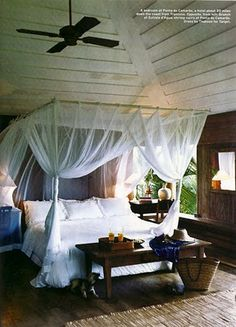 Dreamy room.mall white and sheer and com bed. And then wood accents