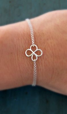It is so delicate and dainty! It is the perfect touch of jewelry. Stylish, cute and feminine. This is set with a double loop of a tiny