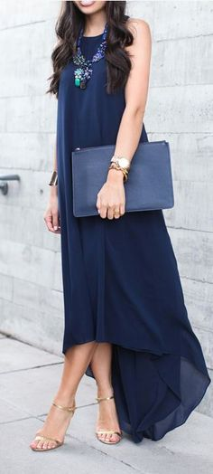 Navy summer maxi dress, statement necklace, matching clutch, golden heels, accessories.