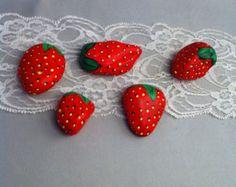 Strawberry painted garden rocks