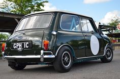 Originally a Surf Blue & Old English White Cooper S , sold  fitted with twin tanks and 4.5J rims , was then painted Cooper Car Co's. Commercial Green and O.E.White , and joined the companys team of Minis