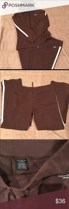Calvin Klein track suit top M bottom XL brown Calvin Klein track suit brown with white trim. The bottoms are a xl with draw string waist. The jacket is a medium. Will separate pieces if need be. Calvin Klein Pants