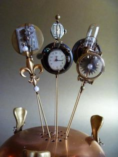 Steampunk hatpins by Lady Bird's Hatberdashery, sold via ClockworkCouture.com
