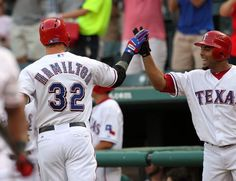 ARLINGTON, TX - AUGUST 10: Josh Hamilton #32 of the Texas Rangers is congratulated by teammate Elvis Andrus #1 after hitting a solo homerun against Max Scherzer of the Detroit Tigers on August 10, 2012 at the Rangers Ballpark in Arlington in Arlington, Texas. (Photo by Layne Murdoch/Getty Images)  game 111