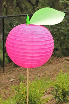 Cute idea to line a walk way for a party. These are fuchsia, but you could do any fruit color: http://www.partylights.com/Lanterns/Fuchsia