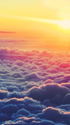 Up in the clouds looking at the sun; clouds for days. Ombré color.