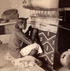 Hopi indian weaving a blanket