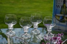 """Take your evening wine to the next level.with these incredible vintage wine glasses! Each glass is a beautiful clear glass with an """"out of this world"""" stem. Love the look and feel of these glasses! This will become your favorite wine glass! Vintage Wine Glasses, Wine Goblets, Summer Cocktails, Clear Glass, 1950s, The Incredibles, Etsy, Beautiful"""