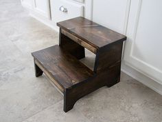 Our rustic step stools are constructed with solid wood, hand sanded, and completed with pocket screws. This stool is finished with a dark walnut stain, and a hand rub polyurethane sealer to make it last for years to come. If you are interested in a different stain or paint color, please message us. We are happy to do custom orders. Perfect for little ones in the bathroom, reaching high items in the kitchen, and more. Dimensions: 12 inches tall, 15 inches wide, 15 inches from front to back…