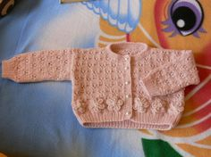Lovely hand knitted made rabbit angora wool warm and soft salmon pink cardigan with little white beads and knitted flowers. For 3 to 6 months old baby. Free shipping.