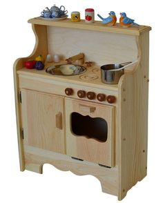 Simple and compact, this new Elves & Angels kitchen design features a top shelf for displaying and storing dishes. Like the Julianna's Kitchen the oven and cabinet compartment provide lots of storage