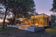 Chinzombo Zambia Villa - a luxurious, chic camp that feels like part of the wild bush, with grass and canvas walls and spacious living areas melting into the landscape.