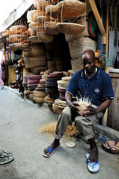 Africa | A basket weaver in the market stalls at Jakande.  Nigeria | ©Lola Akinmade