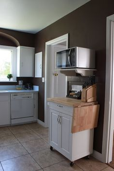 microwave nook--this would be useful in our teensy kitchen, particularly the extra counter space