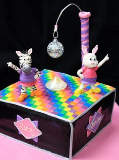 Love the dance floor and disco pets on this awesome cake