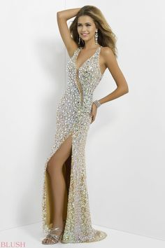 Sexy stones rock this hot gown! This elegant party dress is defined by pearled jewels that slim your figure and define your open-back. A hot v-neck flows into a sheer diagonal beaded illusion.