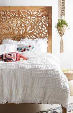 Tonal cords create subtle ruching on a lightweight duvet cover made from stonewashed cotton.