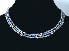 Long necklace antique blue and white striped von Expatrician