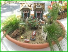 Cute little beachy Fairy Garden....love it...