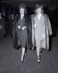 1940s - Posture: Proudly Military A proud, straight bearing wasn't adopted only by women who became WACS, WAVES, or the like, it was also required of fashionable women wearing the broad-shouldered, tailored suits of the time.
