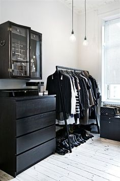 Black furniture white room: