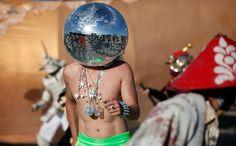 Ciberfy, his Playa name, dances at sunrise in the Black Rock Desert, on August 31, 2012. (Reuters/Jim Urquhart)