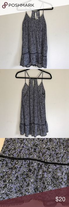 American Eagle Floral Dress Black, purple, and green floral dress with black trim. Has adjustable straps and key hole detail in the back. Can fit sizes XS to M. Worn a few times and in good condition American Eagle Outfitters Dresses Mini