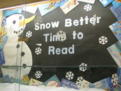 Snowman & winter display. Used book jackets cut at an angle to form border. Snowflakers are strung from top with clear, nylon thread so they spin and move. Quilt batting forms the snow on the bottom of the display case.