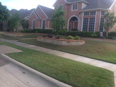 Front lawn landscape design with trees, shrubs and stone/brick border. Flower Bed Edging, Flower Beds, Lawn And Landscape, Landscape Designs, Brick Border, Landscaping Company, Shrubs, Concrete, Bed Ideas