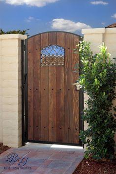 Wood & Iron Gates~ An idea for our side yard gate. Wooden Garden Gate, Metal Garden Gates, Wooden Gates, Garden Doors, Fence Doors, Side Gates, Front Gates, Entrance Gates, Fence Gate Design