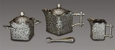 Tea service by Peter Carl Fabergé decorated with stylized central branch coral consisting of a teapot reserves, a milk jug, sugar bowl and sugar tongs. Moscow, 1891.