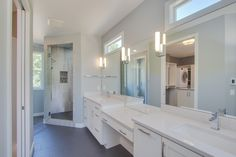 Owners Suite: painted counters, double vanity with make-up counter, ceramic tile floors, coordinating ceramic tile shower with deco tile niche accent